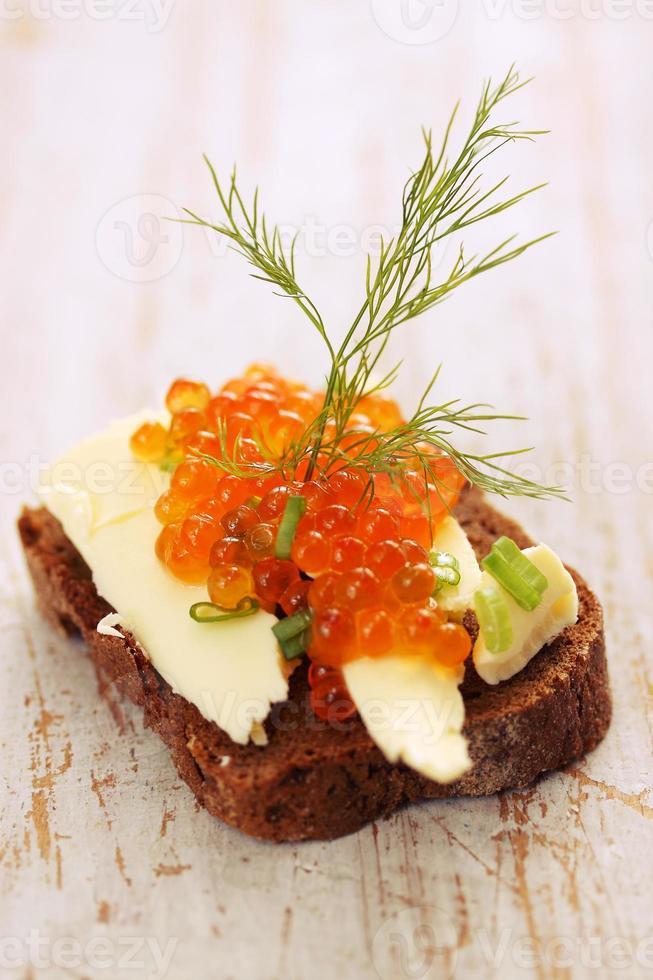sandwich with butter, caviar photo