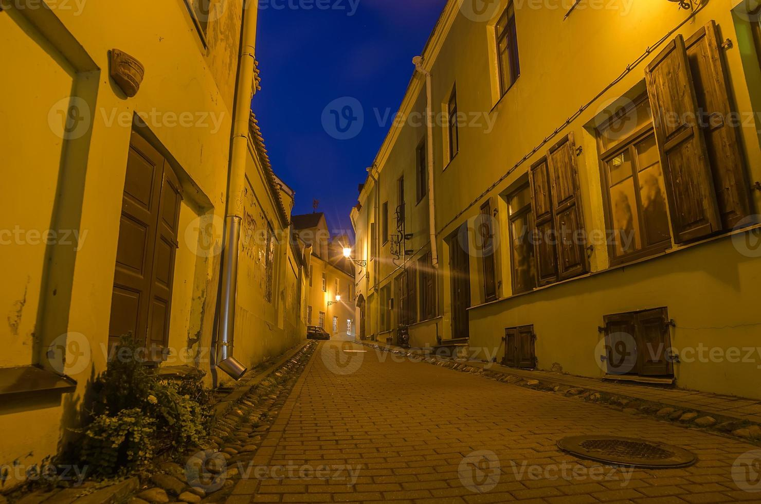 Street in the Old Town of Vilnius, Lithuania photo