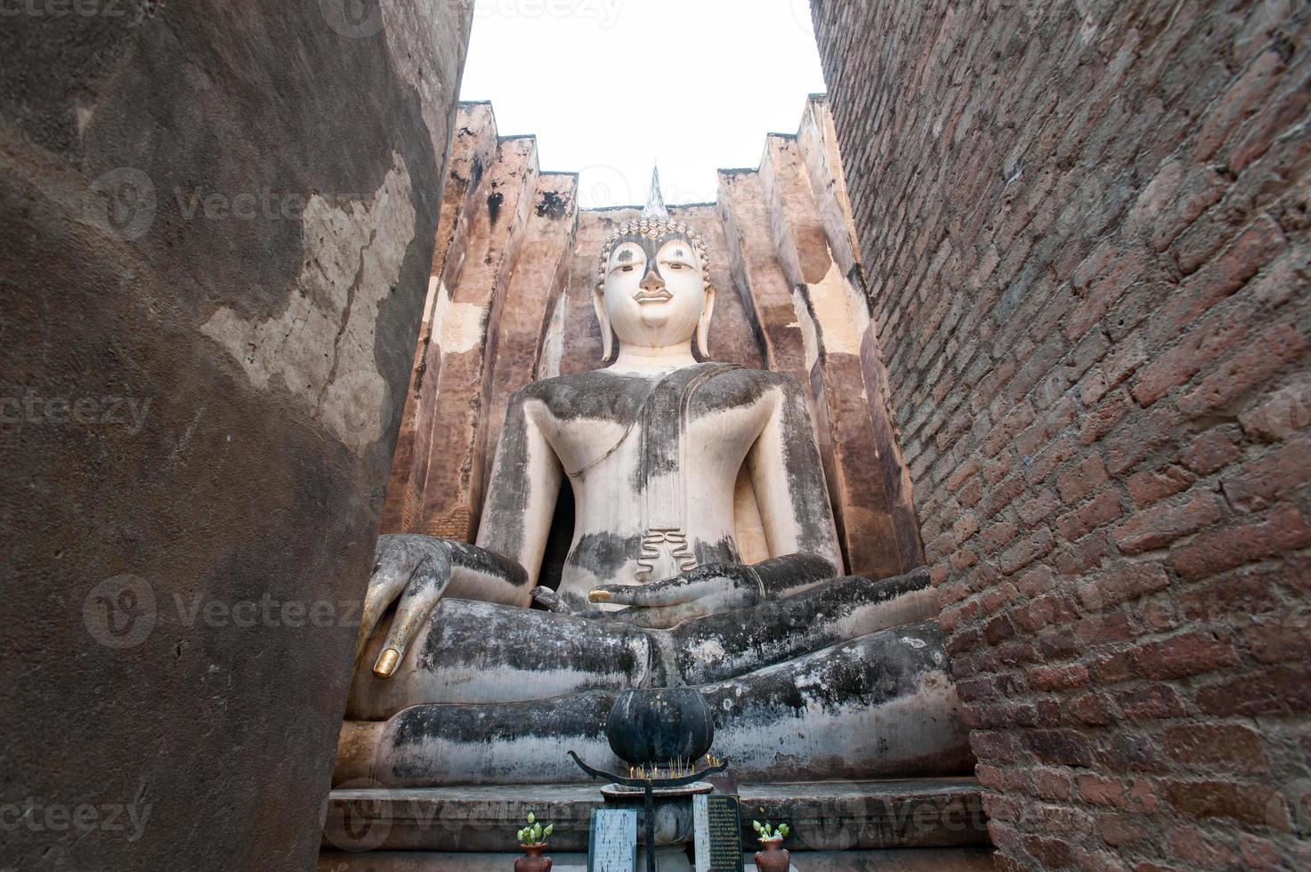 Ancient buddha statue. Sukhothai Historical Park,Thailand photo