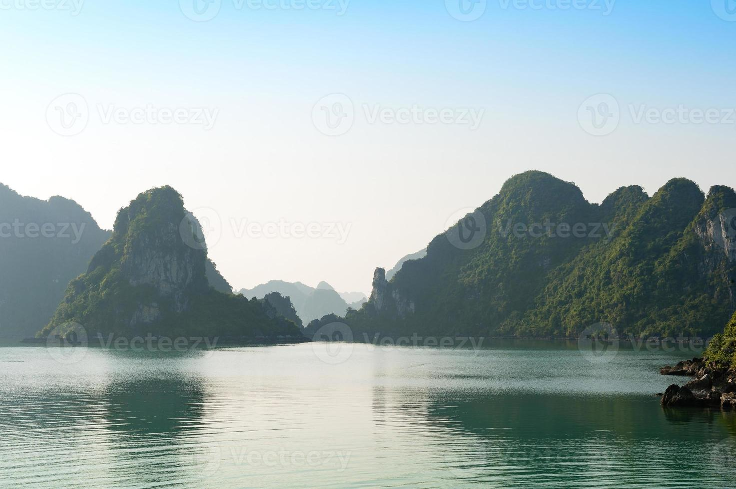 Ha Long bay and silhouettes mountains vietnam photo