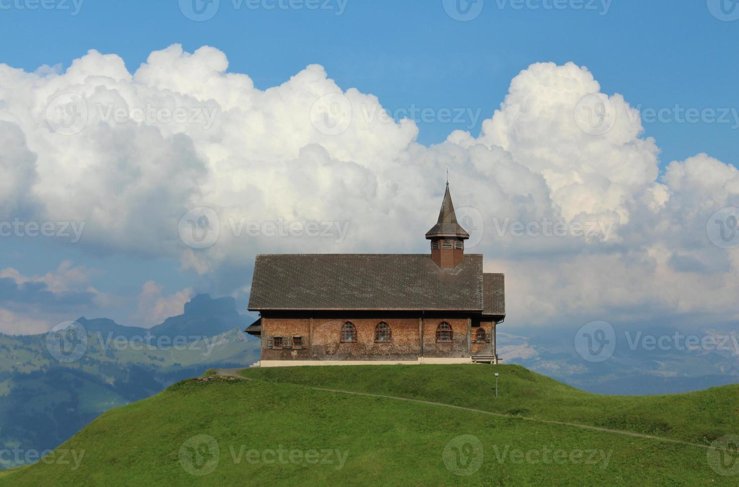 Old chapel on a green hill photo