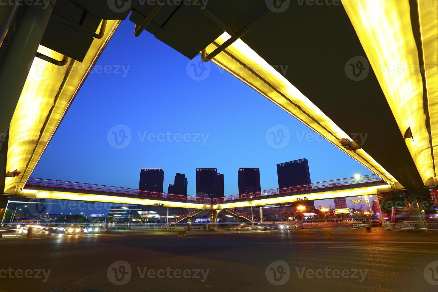 Urban footbridge and road intersection of night scene photo