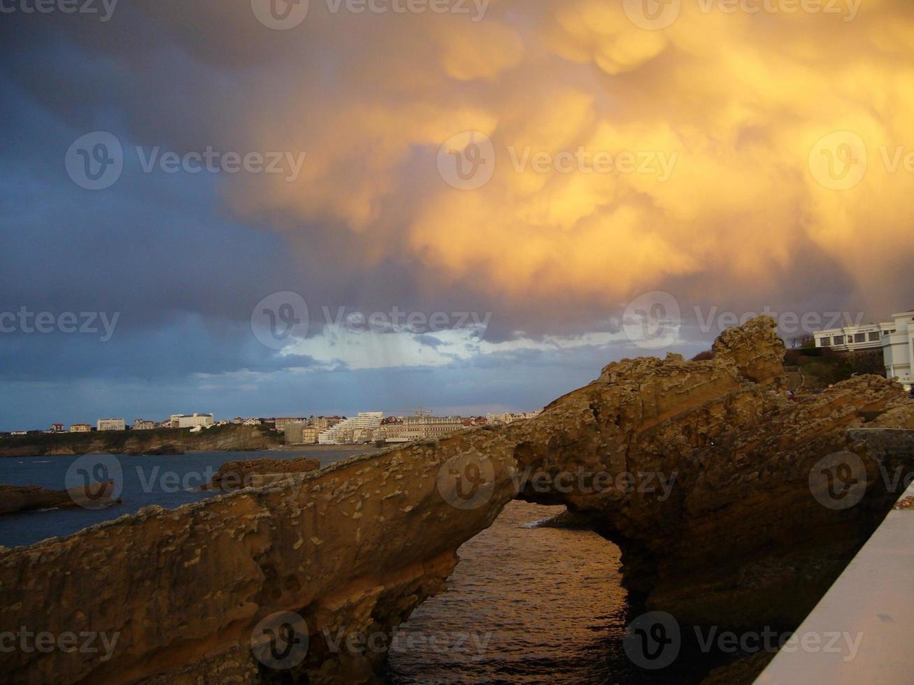 Biarritz coastline and yellow sky photo