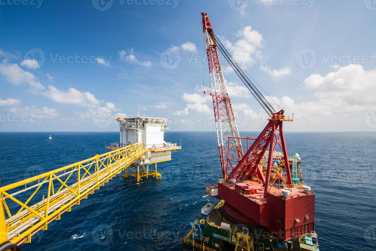 Large crane vessel installing the platform in offshore photo