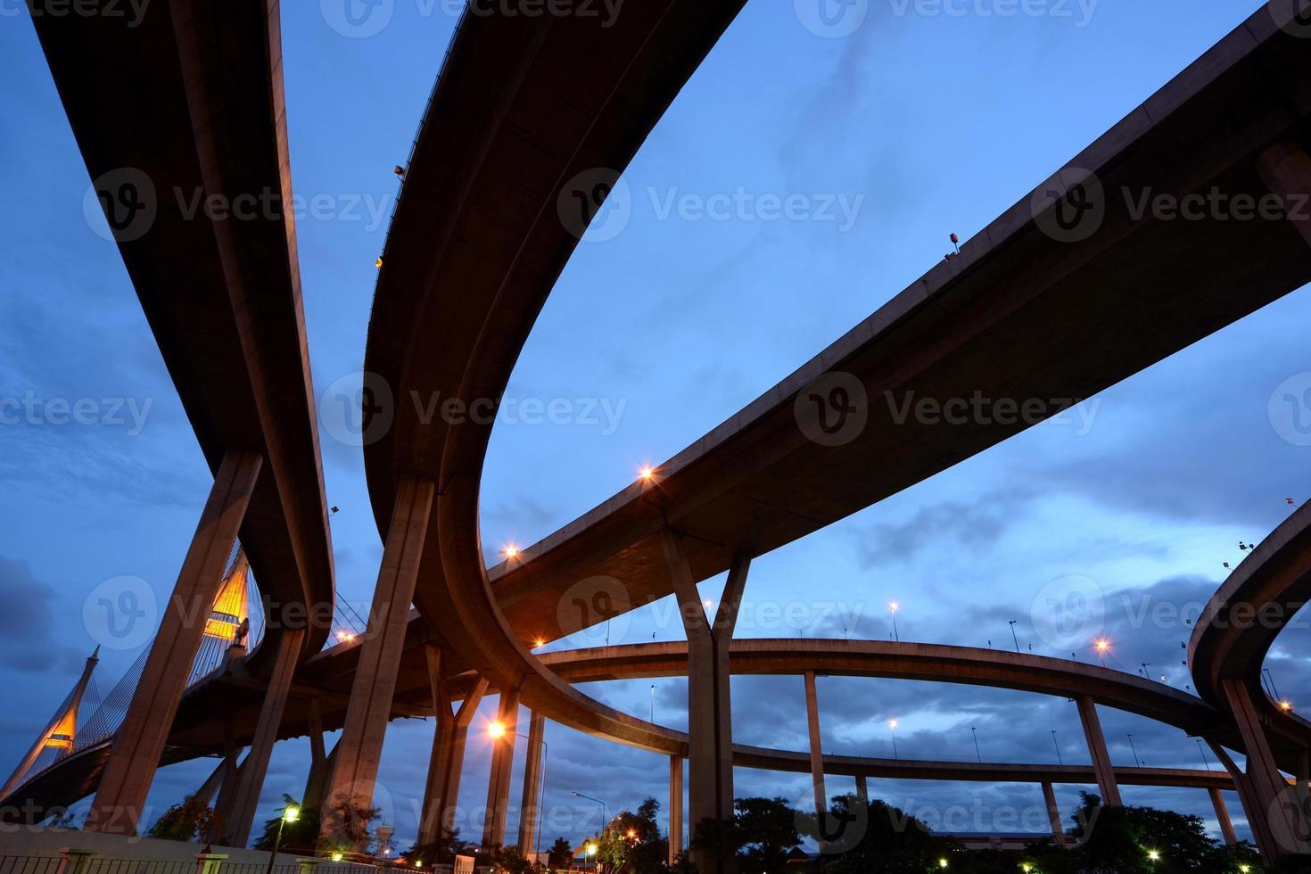 Industrial road bridges cross the river in Bangkok, Thailand photo