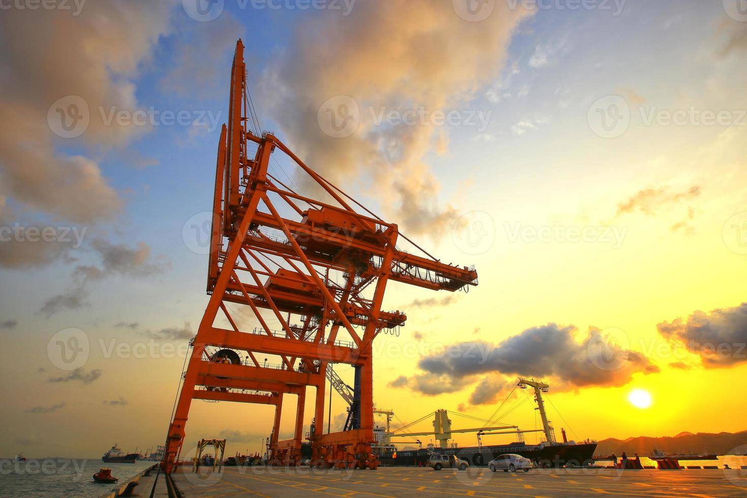 Container Cargo freight ship with working crane bridge photo