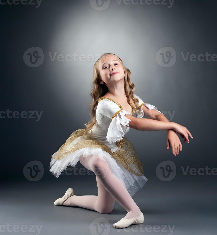 Image of nice little ballerina posing at camera photo