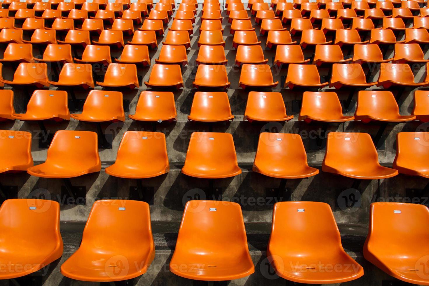 Front of the orange seats on  stadium photo