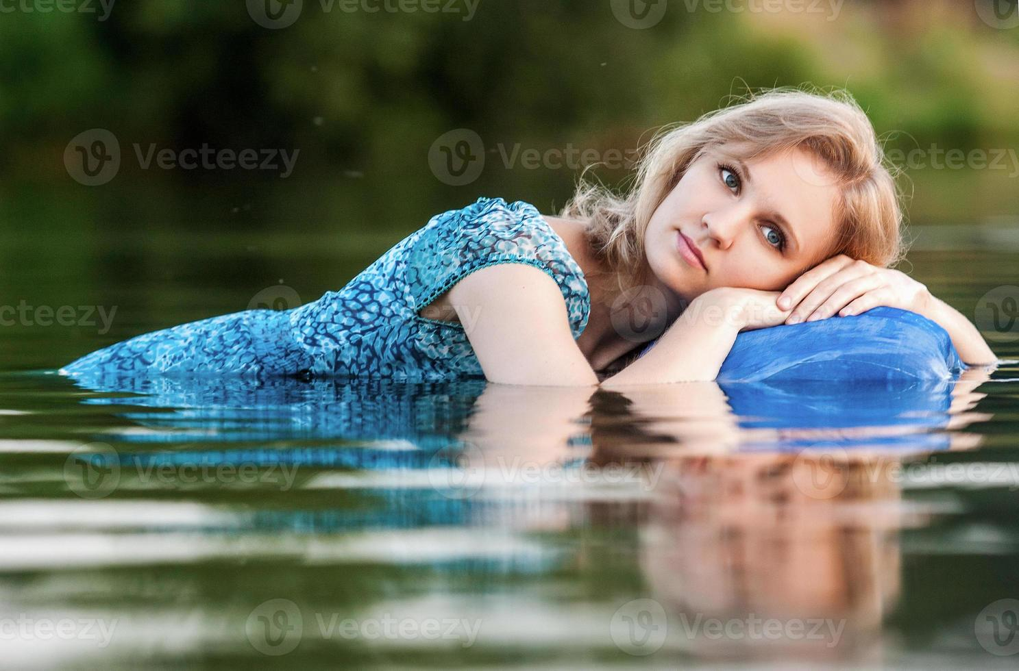 Young and beautiful  girl in the river. photo
