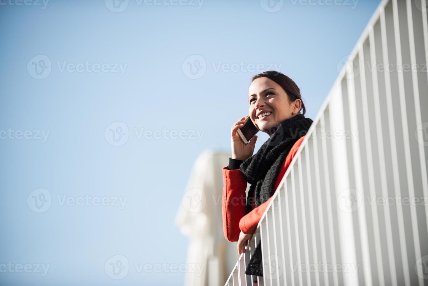 Smiling woman on a terrace photo