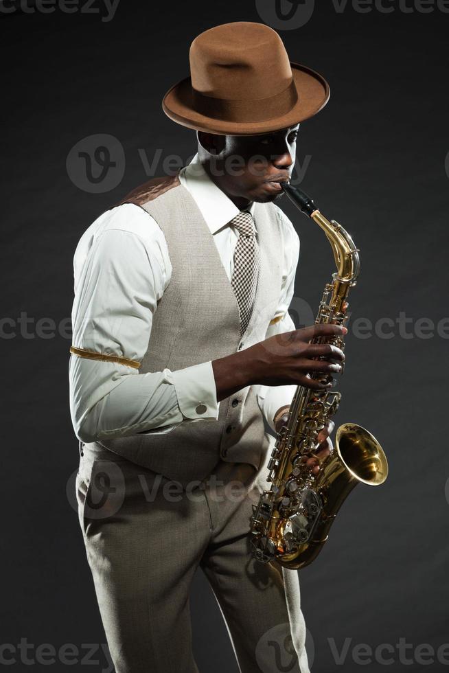 Black american jazz saxophone player. Vintage. Studio shot. photo