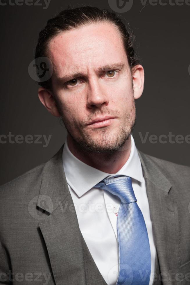 Business man long hair wearing grey suit. photo