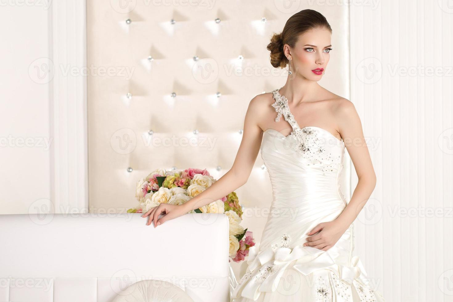 Gorgeous bride in a white room photo