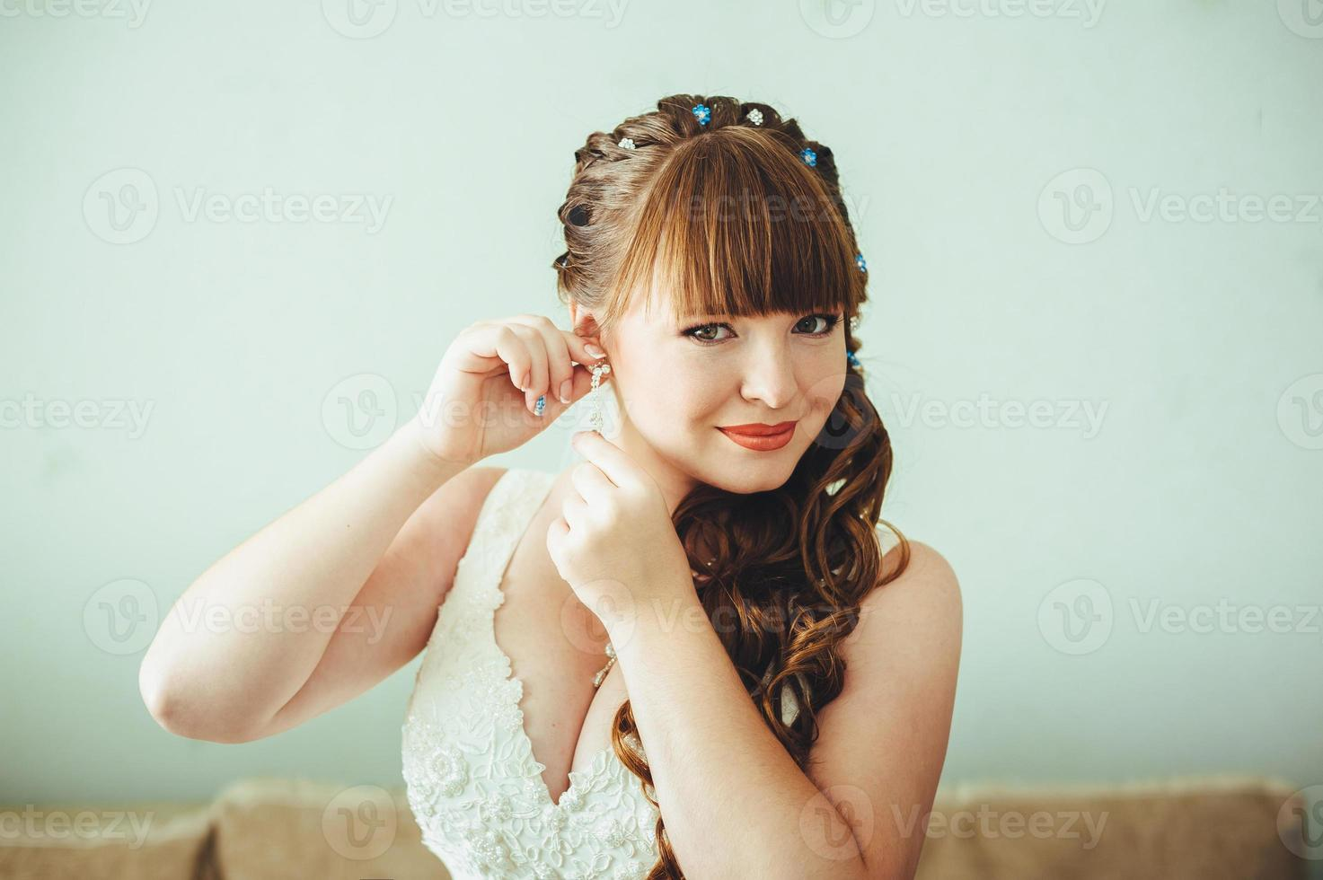 Bride getting ready in the morning. Woman dressing gown photo