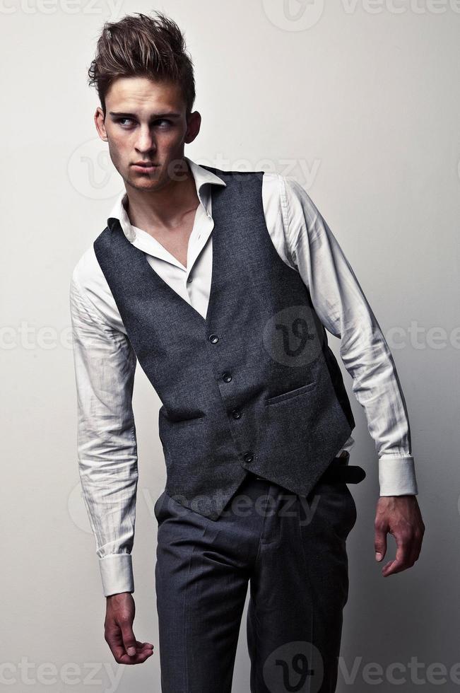 Elegant young handsome man. Studio fashion portrait. photo