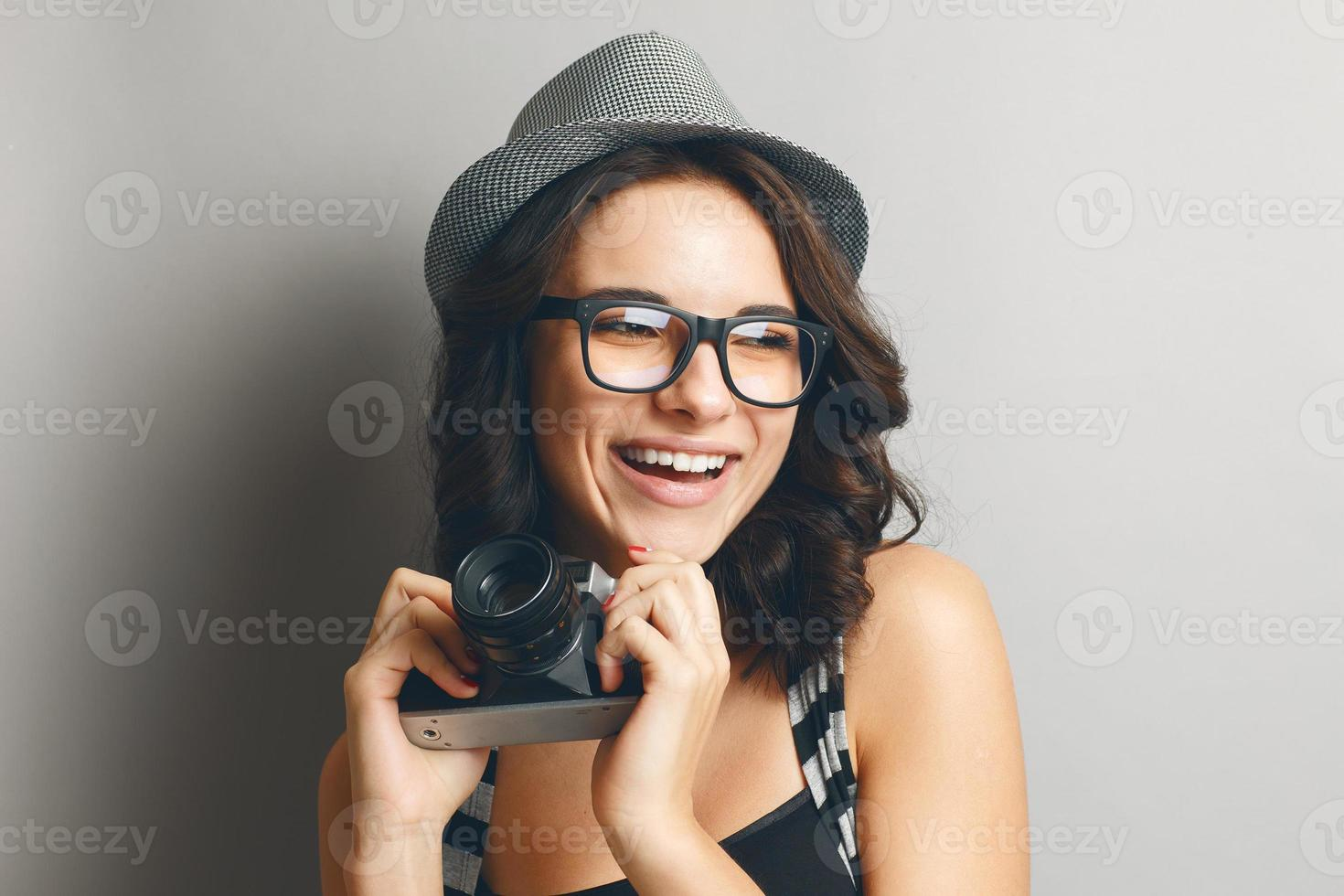 Beautiful girl in a hat and glasses. photo