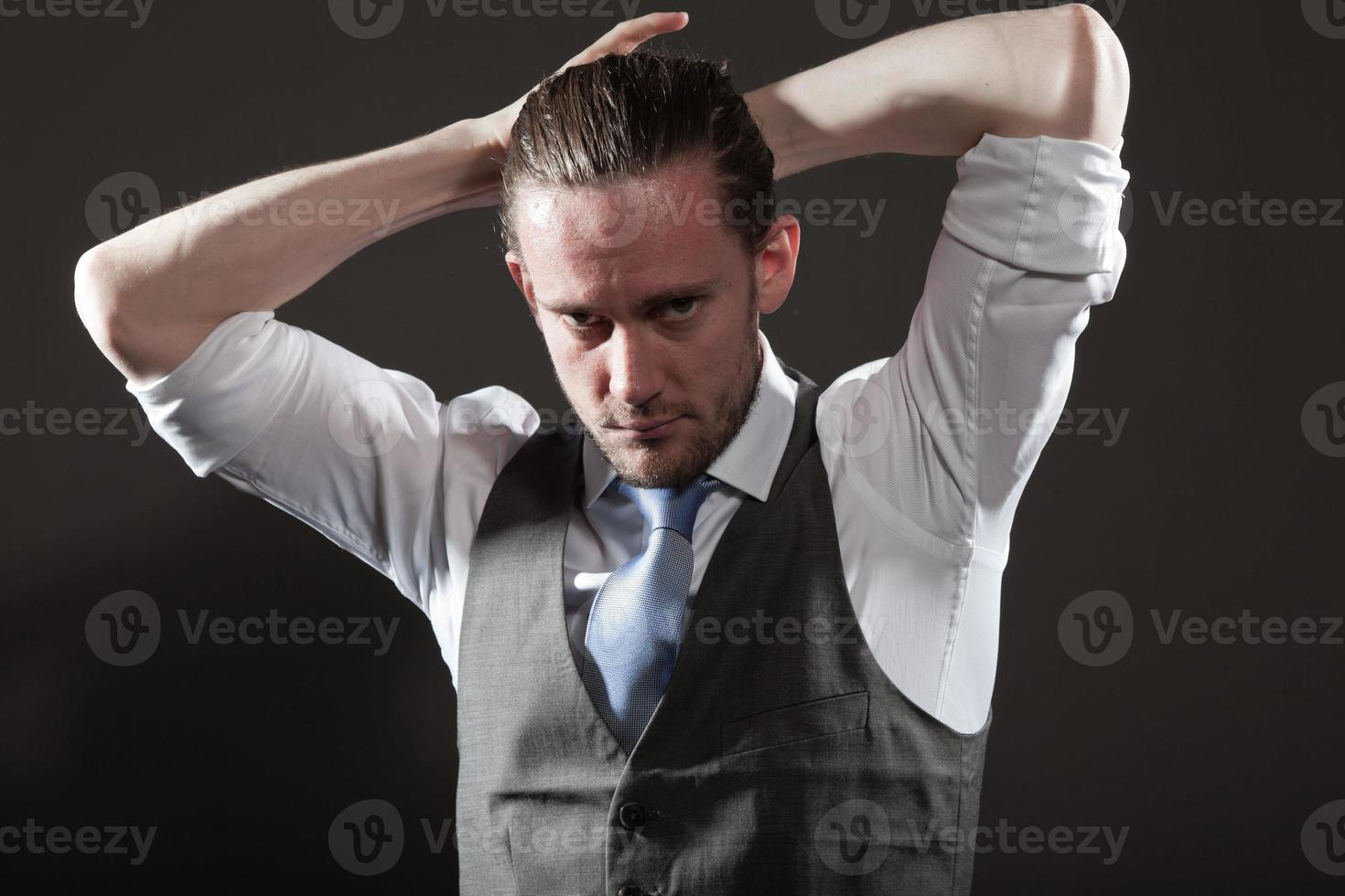 Young man long hair expressive face wearing suit and tie. photo