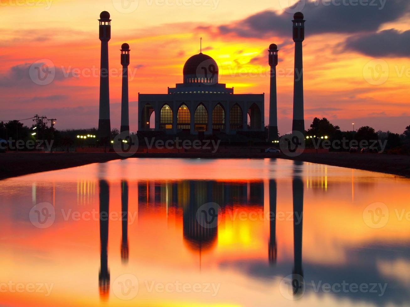 Mosque in sunset scene photo