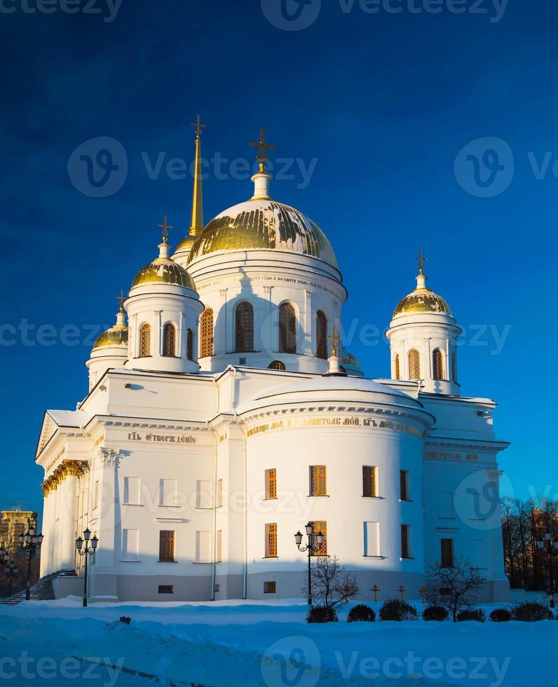 Orthodox golden domes against the dark blue sky photo