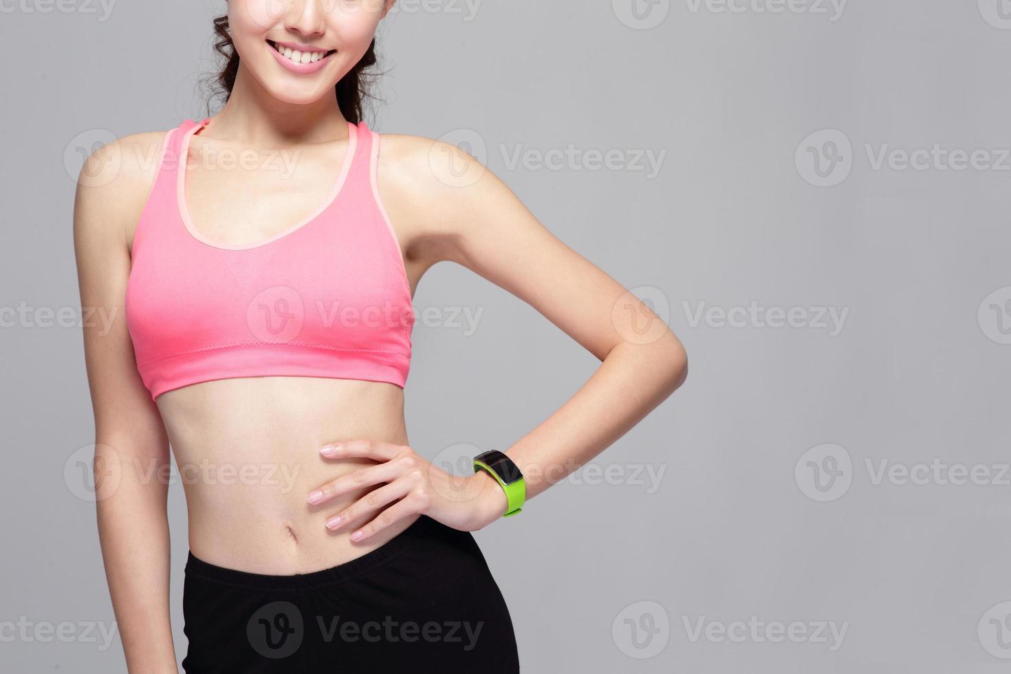 sport woman wearing smart watch photo