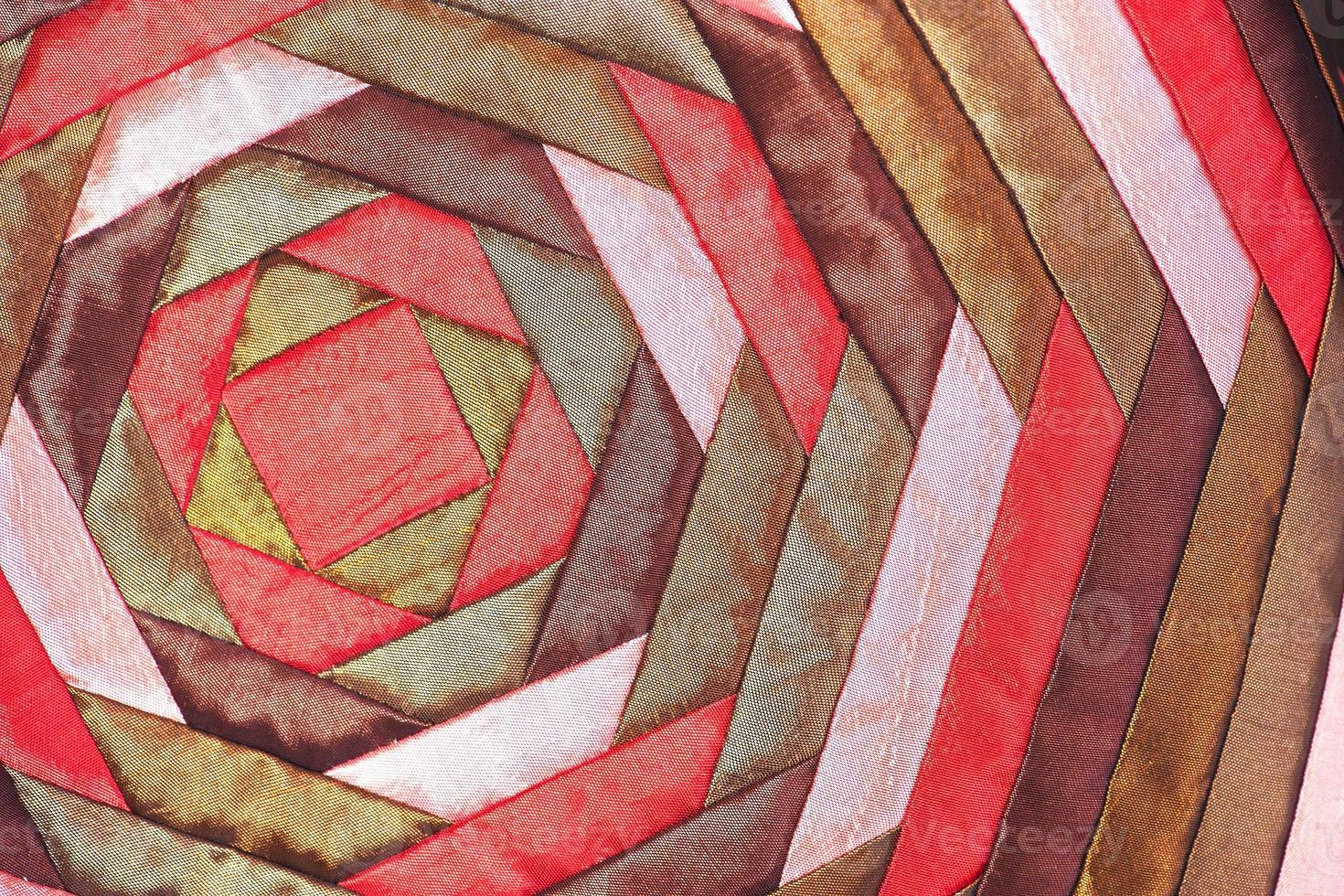 Superficie de alfombra colorida artesanía de seda tailandesa estilo peruano de cerca foto