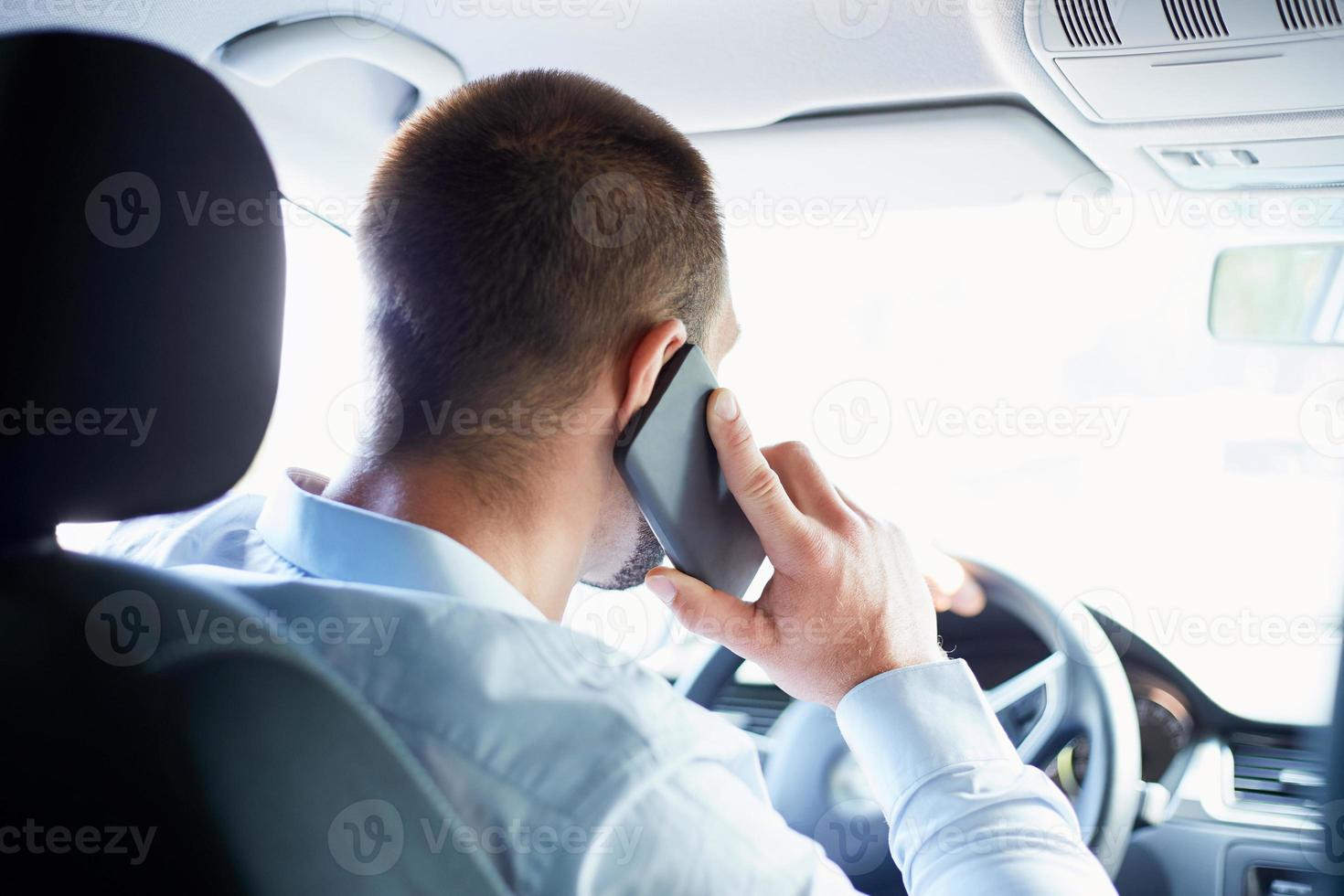 Young businessman in car photo
