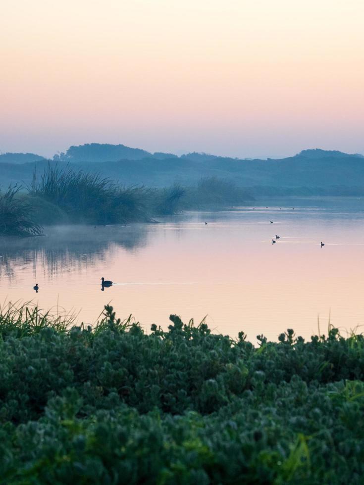 View of a lake at dusk photo