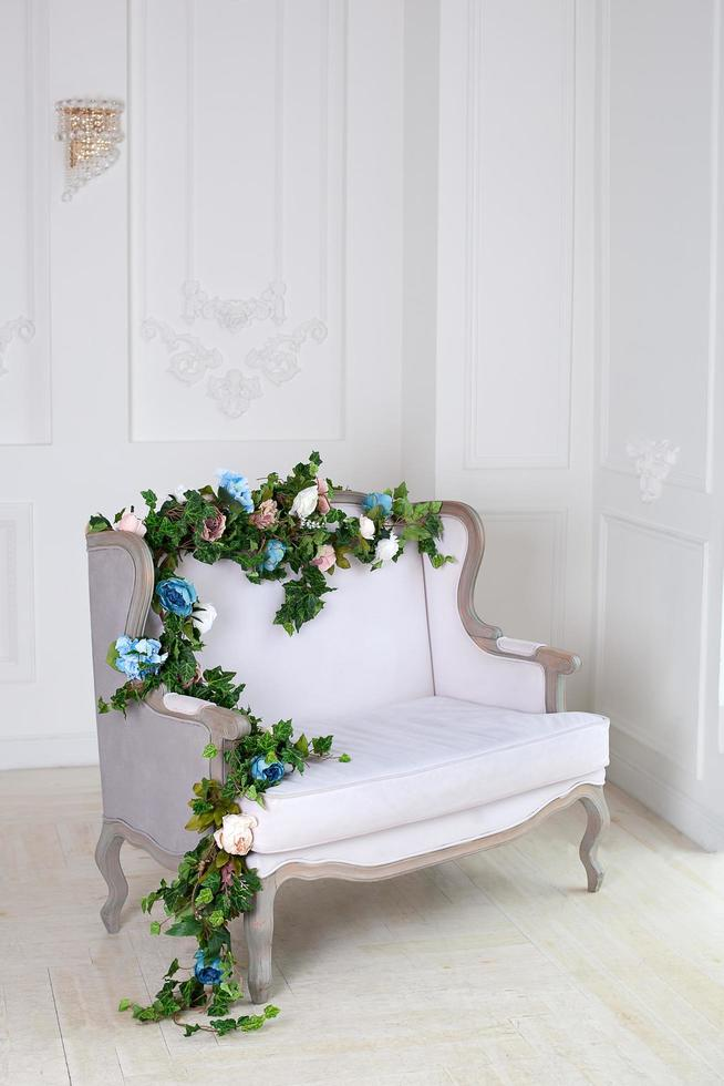 Light textile sofa in a vintage room. photo