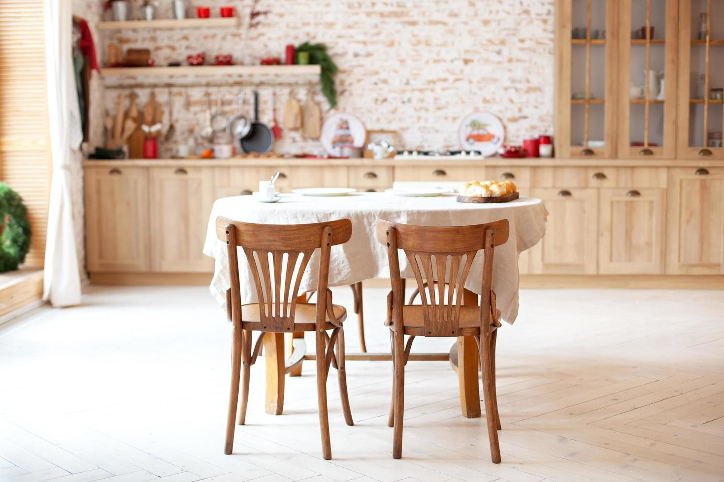 Stylish kitchen interior with wooden table and chairs photo