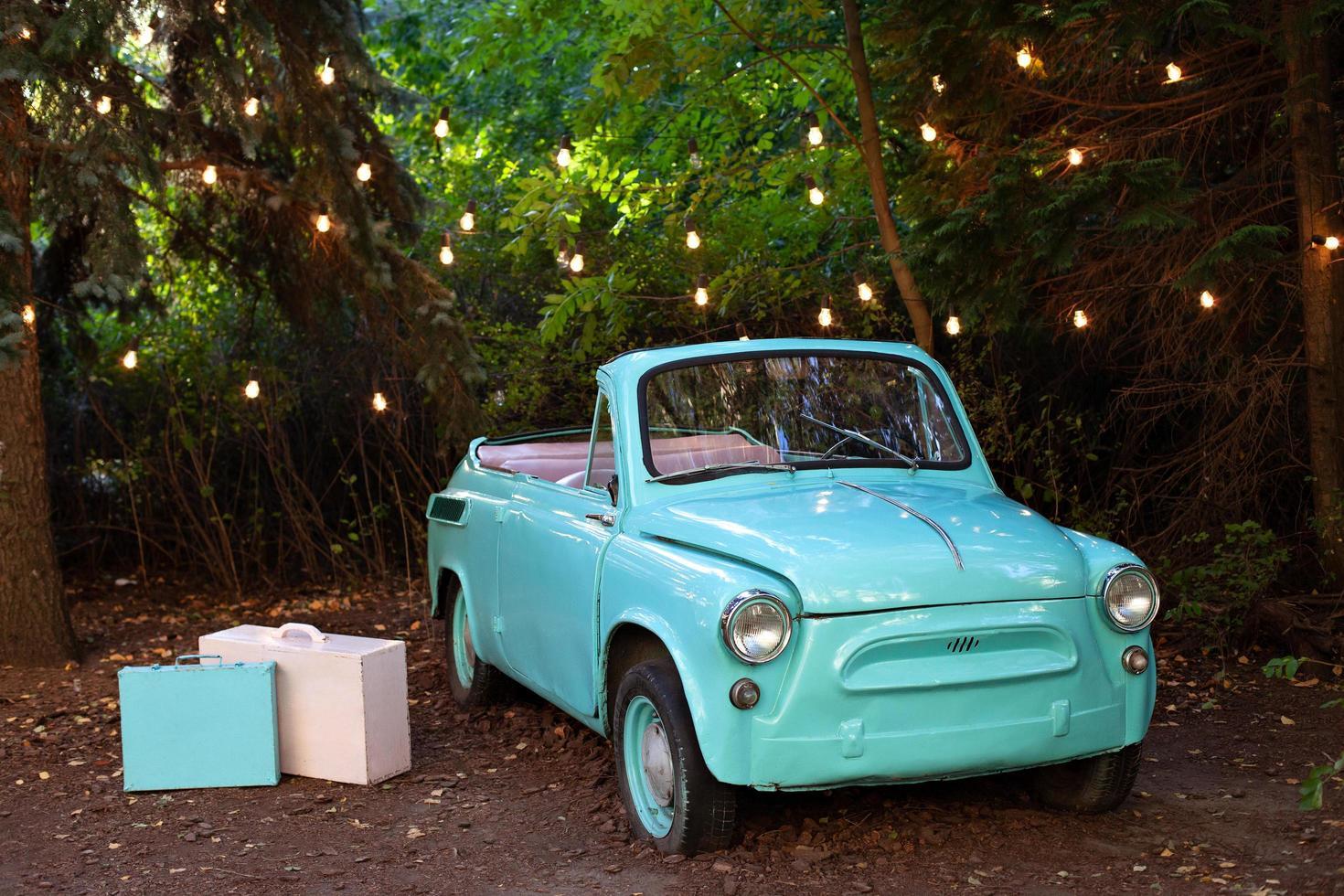 Retro small vintage turqouise car  photo
