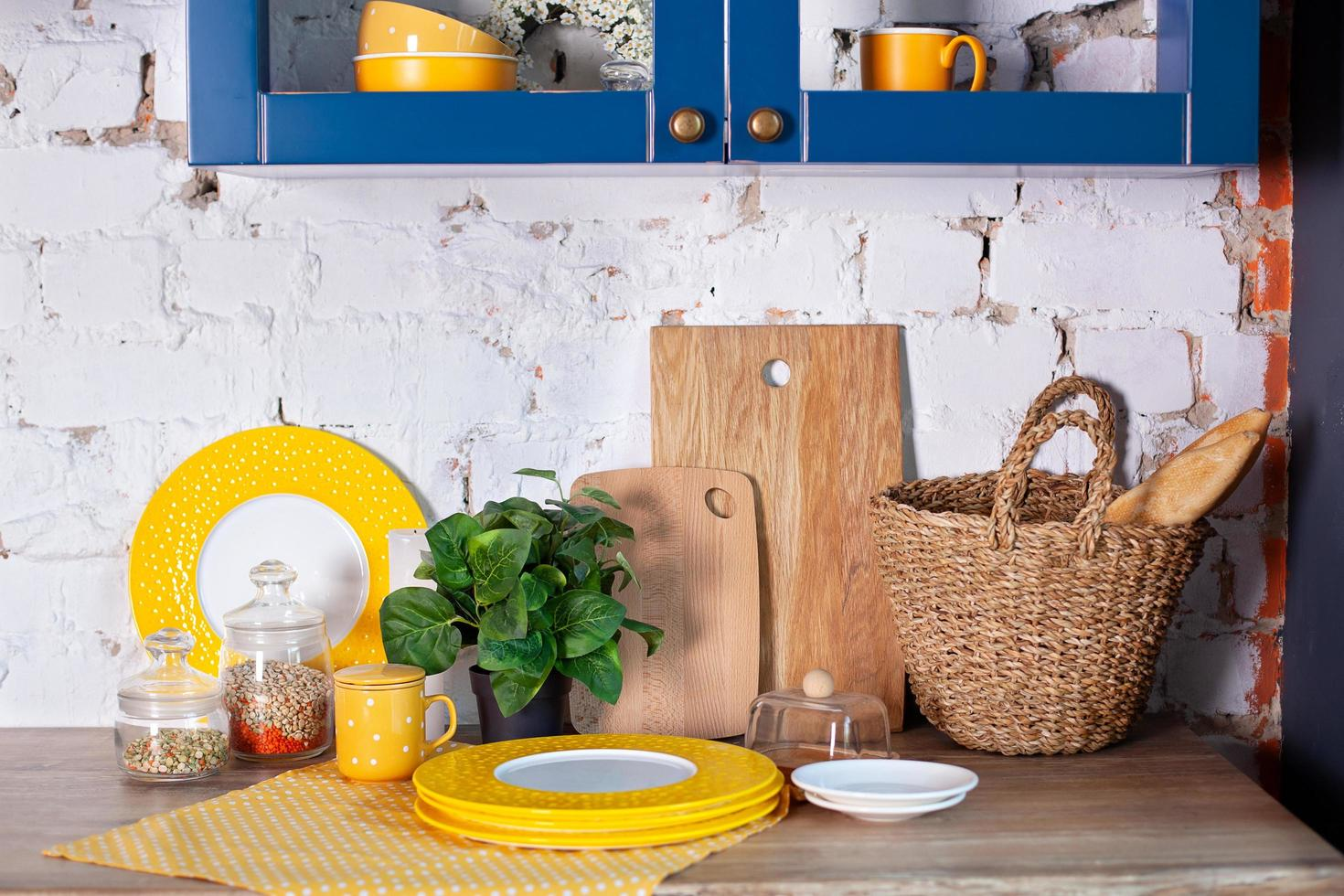 Modern kitchen with cooking utensils and clean dish ware. photo