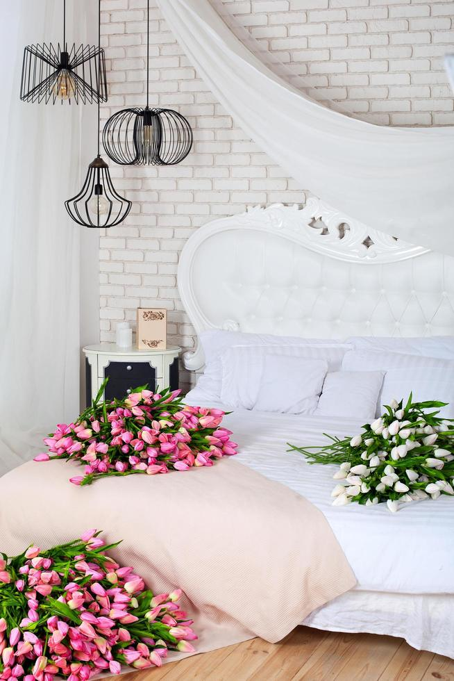 Romantic morning in a chic bedroom with tulips photo