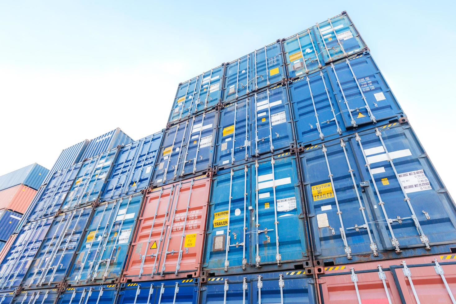 Stack of container boxes in shipyard photo