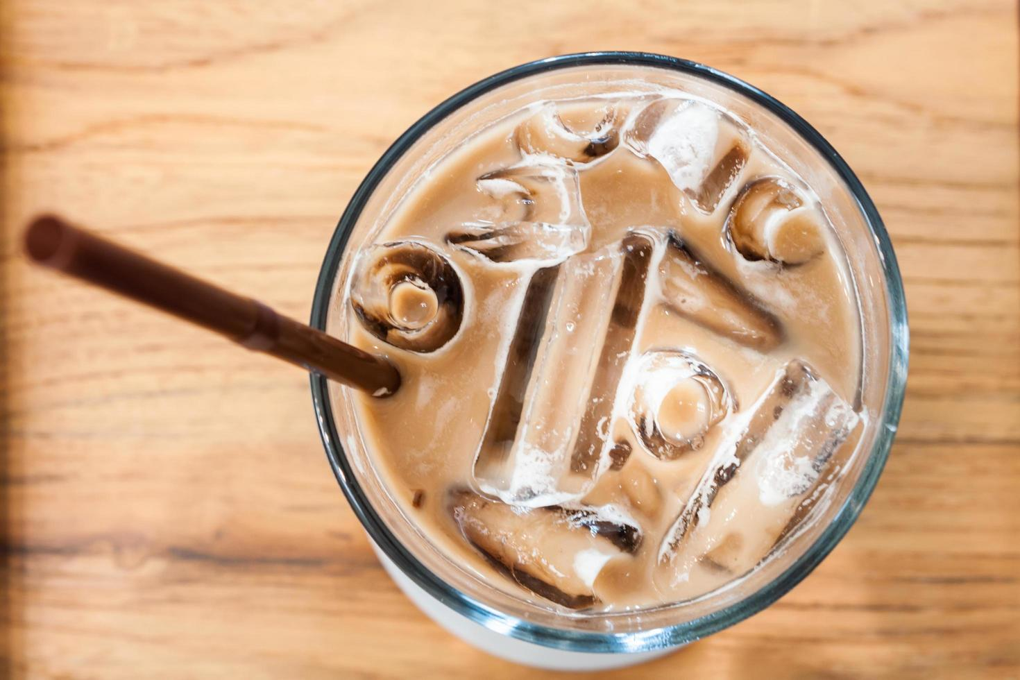 Iced coffee in coffee shop on wooden table photo