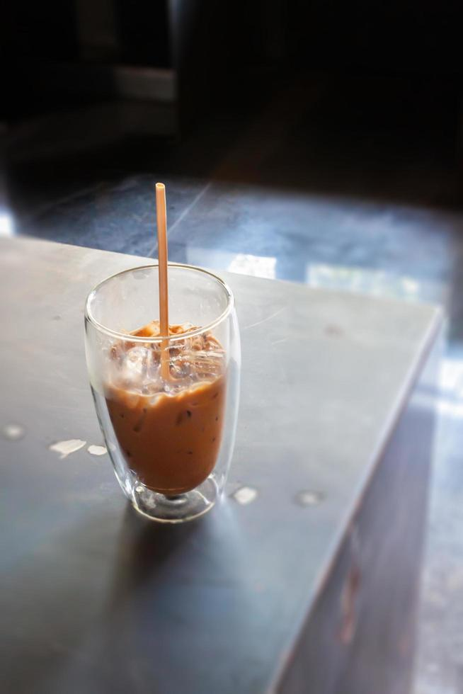 Iced coffee in coffee shop on top of wooden table photo