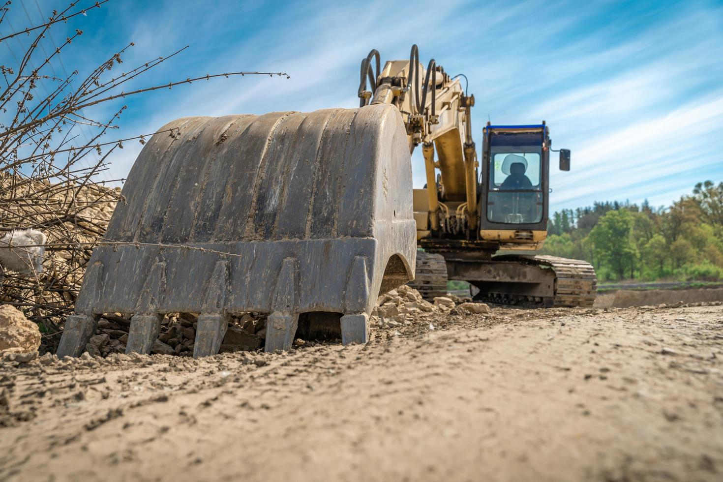 Excavator parked on construction site photo