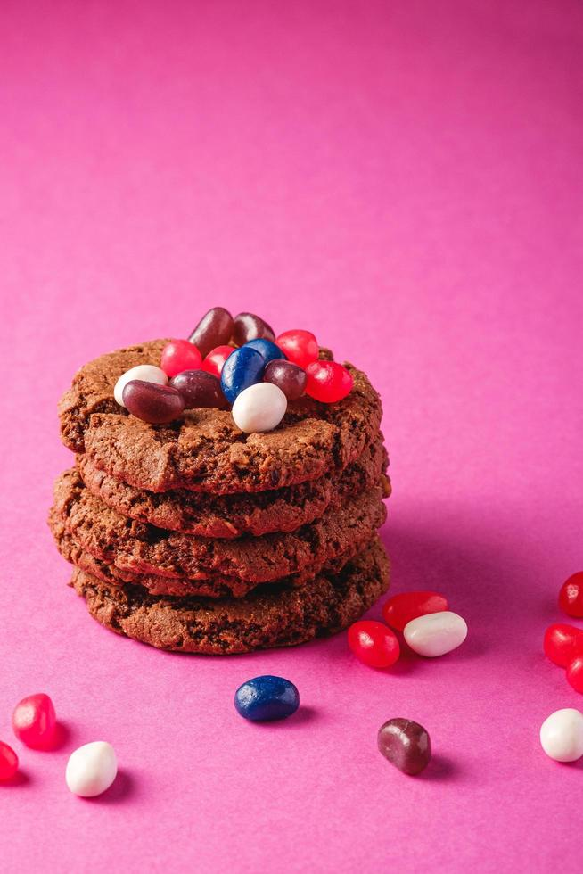 Cookies stacked on minimal pink purple background photo