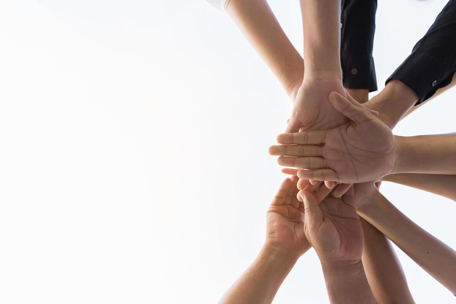 Human hands in a team huddle photo