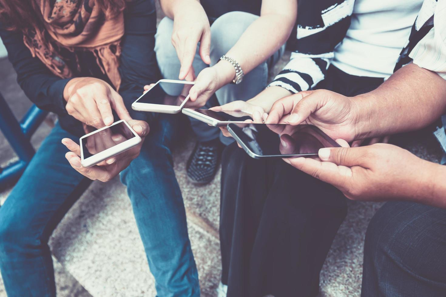 Group of people using smart phones photo