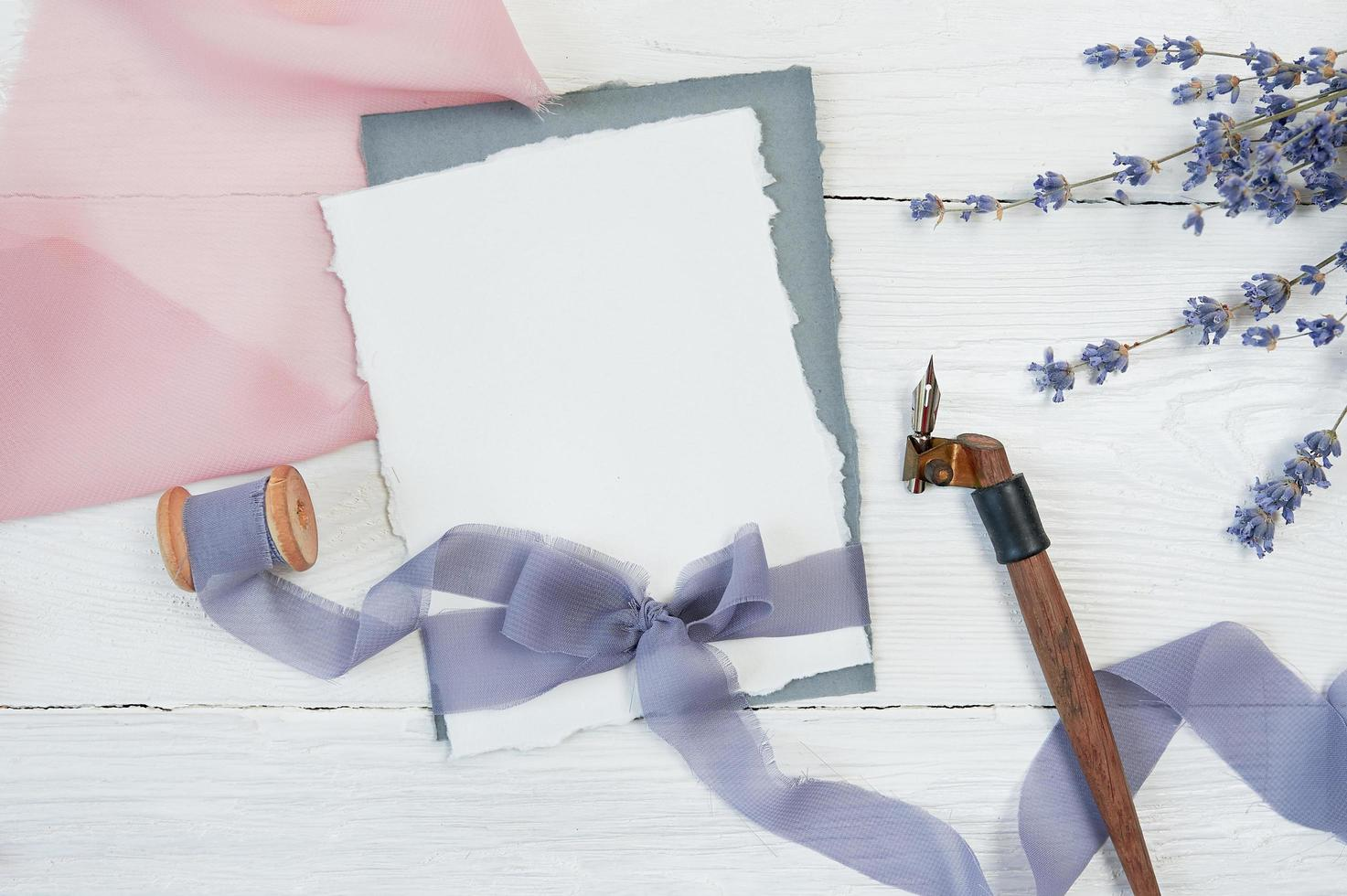 White blank card with ribbon on neutral background  photo