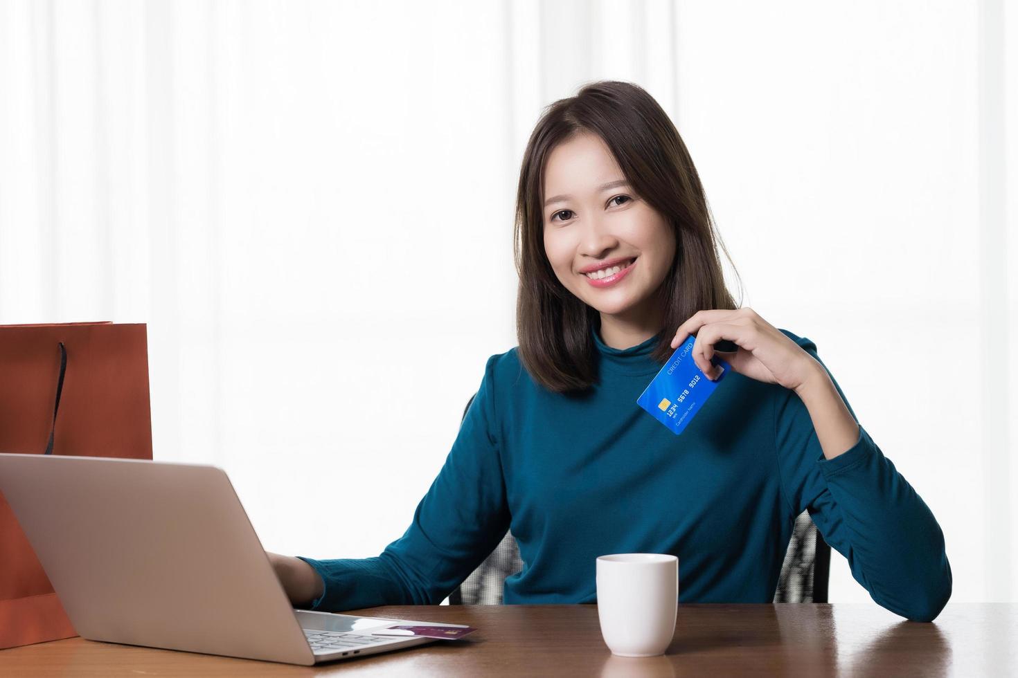 Asian woman shopping online  photo