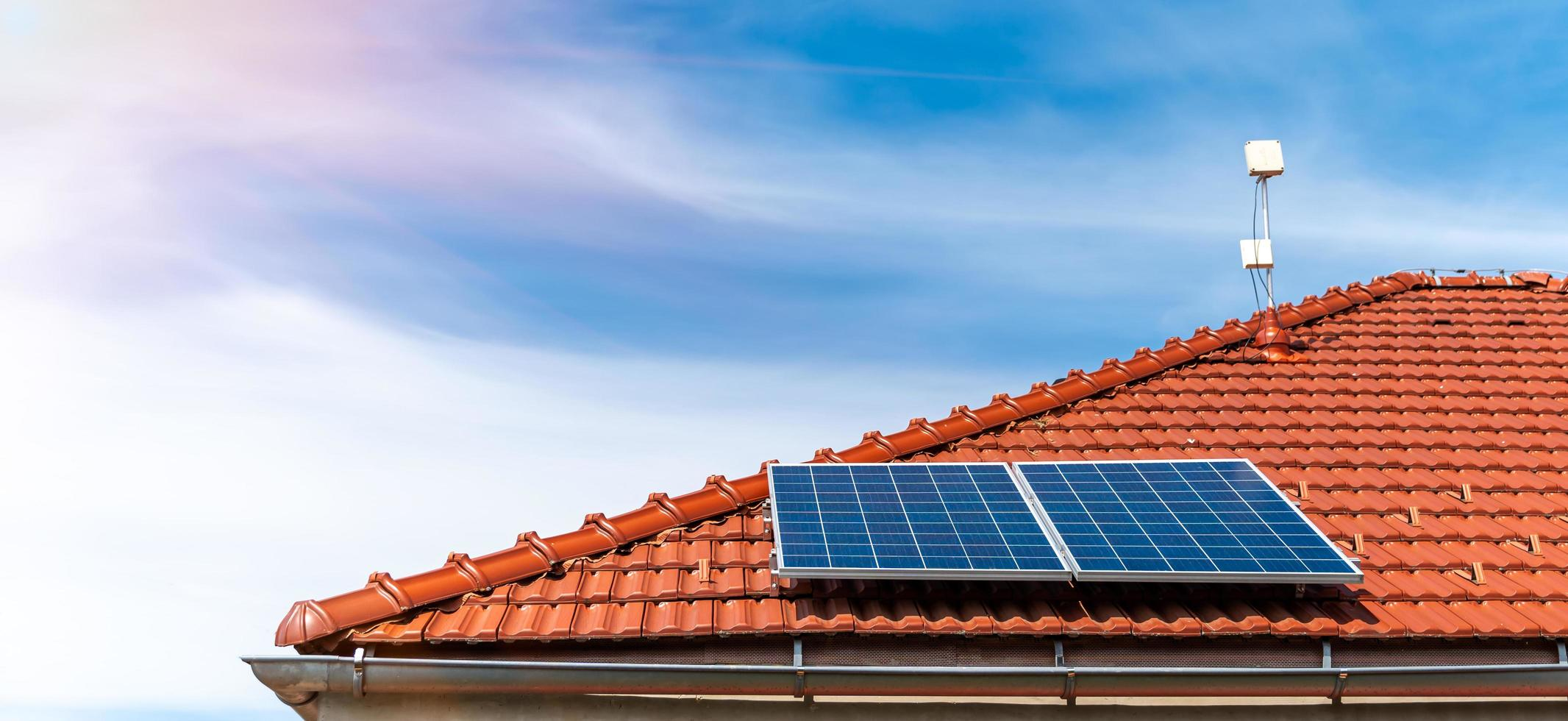 Solar panels on the roof of a family house photo