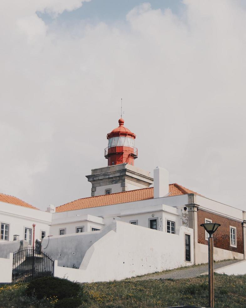 Lighthouse on a hill in Portugal photo