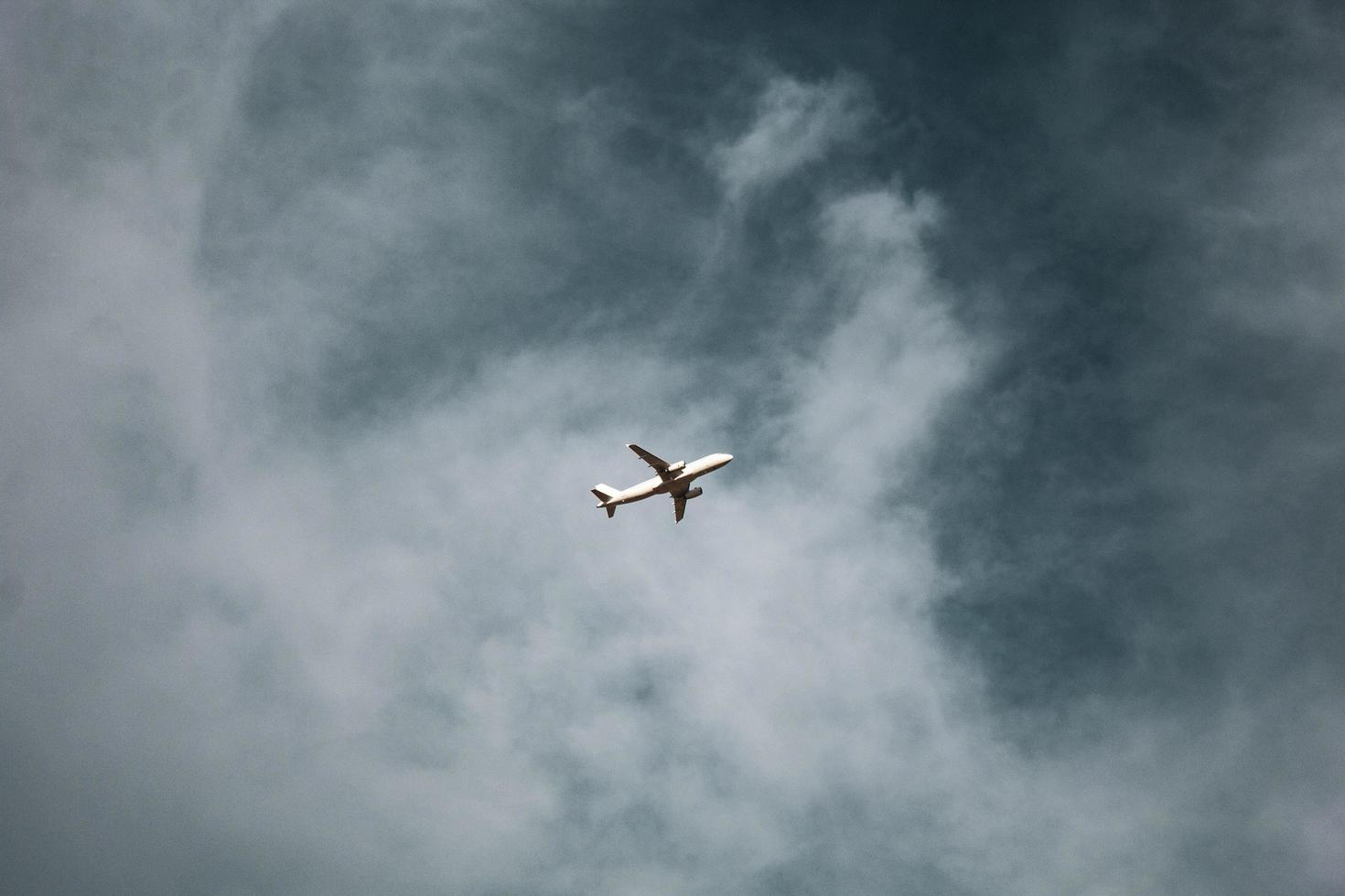 Plane with blue cloudy sky photo