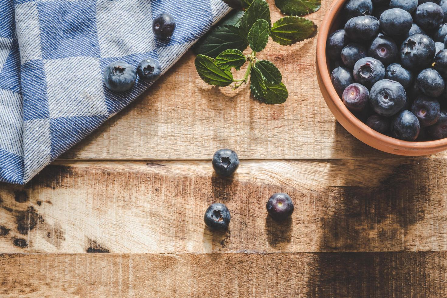 Blueberries in dish on table photo