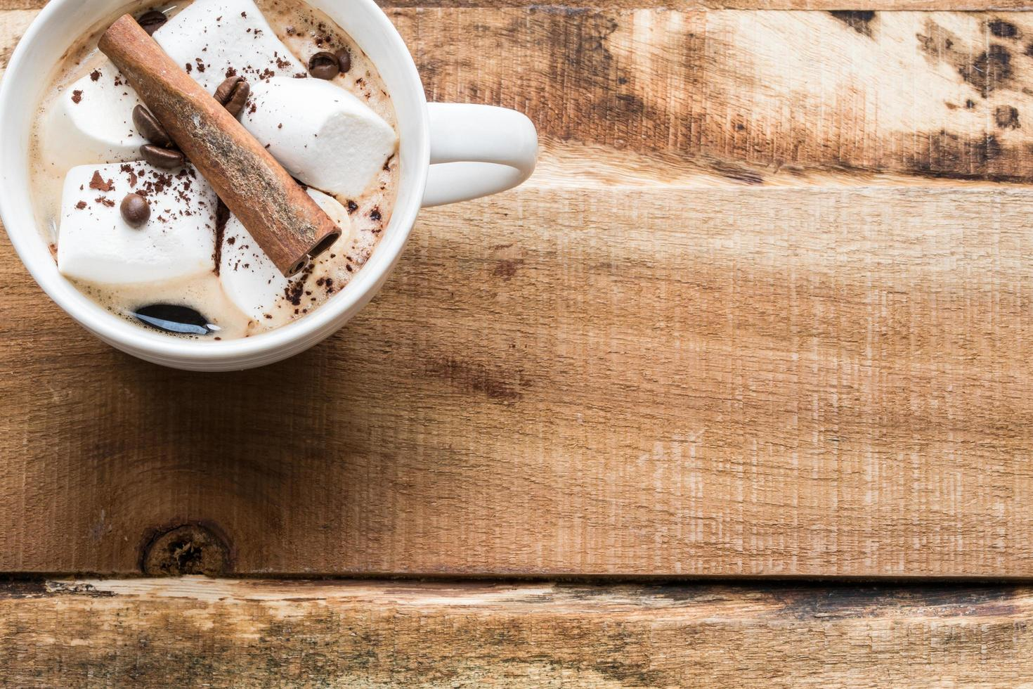 Coffee on wooden surface photo