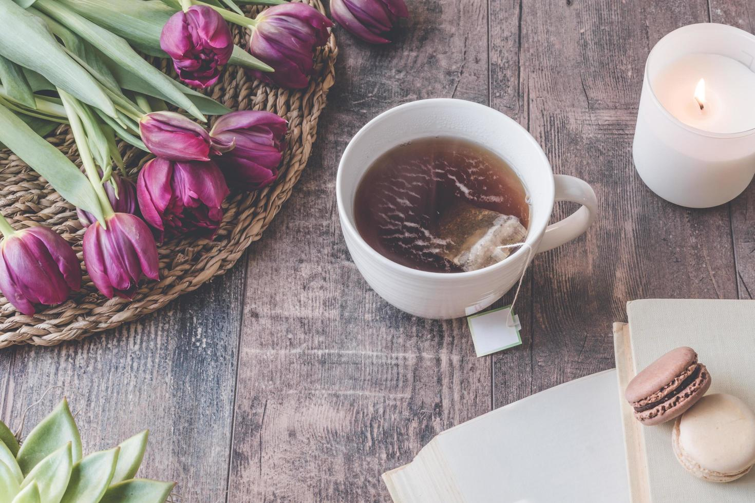Lifestyle of tea, flowers and macarons  photo