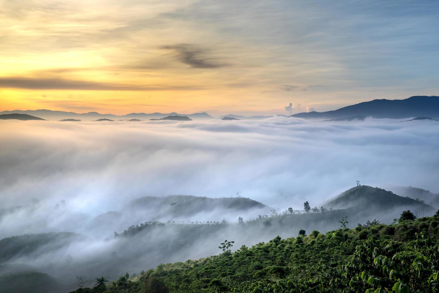 Cloudy misty hills and sunset photo