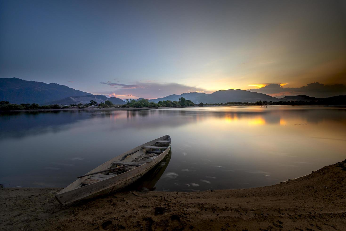 Wooden boat on shore photo