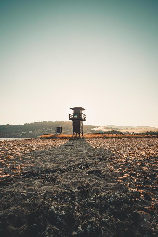 Lifeguard tower on beach photo